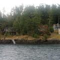 Homes along the shoreline.- San Juan Island: Friday Harbor Sea Kayaking