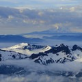 Mount Adams (12,281') behind Stevens, Tatoosh, Boundary, Unicorn and Foss Peaks.- Mount Rainier: Disappointment Cleaver Route