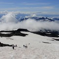 The Muir Snowfield with the Tatoosh Range in the clouds.- Mount Rainier: Disappointment Cleaver Route