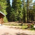The vault toilet facility at Barlow Crossing Campground.- Barlow Crossing Campground + Campsites