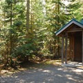 The vault toilet facility at White River Campground.- White River Station Campground