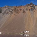 Colorful rock slides below Hillman Peak, the highest point on the rim (8,156').- Crater Lake Boat Tour