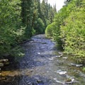 Looking downstream as the North Umpqua River heads to Toketee Falls, lake and campground.- Umpqua Hot Springs