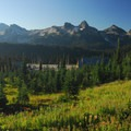 View looking south at the Paradise Lodge and Tatoosh Range from the Skyline Trail.- Skyline Trail Hike