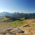 Panoramic view south of the Tatoosh Range with Mount Adams (12,281') and Mount St. Helens (8,365') in view.- Skyline Trail Hike