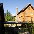 National Park Inn with the General Store (originally the Hiker's Center) at left.- Longmire + National Park Inn