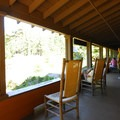 National Park Inn's covered front porch.- Longmire + National Park Inn