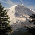 A glimpse of Mount Rainier (14,411') en route to George Lake.- Gobblers Knob + Lake George Hike