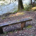 Benches along the riverside trail.- Whispering Falls Campground