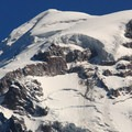 Mount Rainer's Liberty Cap summit (14,112 ft) from Eagle Cliff along the Spray Falls Trail.- Mount Rainier National Park
