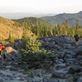 Wayfinding over the lava flow toward Chocolate Falls.- Mount St. Helens Worm Flows Hike
