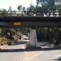 A train bridge across El Capitan State Beach Road.- El Capitan State Beach