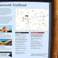 Signage at the Sawtooth Trailhead. - Glacier Pass, Sawtooth Pass + Big Five Lakes Hiking Loop