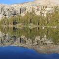 Middle Little Five Lake reflection.- Glacier Pass, Sawtooth Pass + Big Five Lakes Hiking Loop