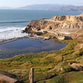 The Sutro Baths with the entrance to the Golden Gate and Marin County in the distance.- Lands End Lookout + Sutro Baths