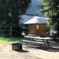 An adveture yurt complete with picnic tables and fire pits. - El Capitan Canyon Nature Resort