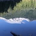 Mount Jefferson reflected on Pamelia Lake.- Pamelia Lake + Grizzly Peak