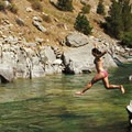 For a change of temperature, soakers can jump into the river's colder water.- Kirkham Hot Springs
