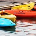 Kayaks and paddle boards tied to the dock at Redfish Lake Lodge.- Redfish Lake
