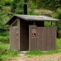 Vault toilets in Paradise Campground.- Paradise Campground