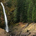 The falls are a beautiful backdrop as you start your short hike from the trailhead.- Terwilliger Hot Springs