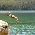 Swimmers can jump from the small boulders at the lakes edge.- Redfish Lake