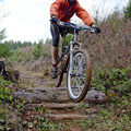 Dropping off one of the man-made trail features at Whypass.- Carpenter Bypass Trail System, Whypass Trail
