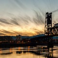 Downtown Portland and the Steel Bridge at sunset from the Eastbank Esplanade.- Vera Katz Eastbank Esplanade
