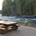 The patio next to the lodge offers a great view of the river.- Belknap Hot Springs Resort