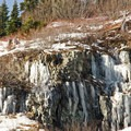 Ice clings to the sheer rock faces in the late fall, warning of potentially slippery trail ahead.- Mount Margaret via Norway Pass