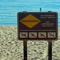 This sign is no joke: the air temperature may be warm, but the water is always cold.- Lake Tahoe, Rubicon Point to Tahoe City Paddle