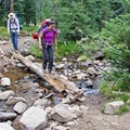 Small creeks on the trail are crossed using logs or stepping stones.- Washington Lake