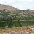 The nearby mountains and ridges provide options for day hikes from the lakeside camp.- Washington Lake