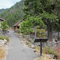 Changing areas and educational signage along the short trail to the hot springs.- Sunbeam Hot Springs