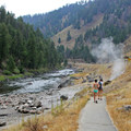A paved path along the highway leads to the river's edge where the hot water mixes in.- Sunbeam Hot Springs