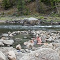 The pools are hidden among the collections of small boulders.- Sunbeam Hot Springs