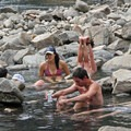 Soakers in various forms and postures.- Sunbeam Hot Springs