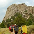 Visitors carry climbing crash pads for protection on tricky bouldering problems.- Castle Rocks State Park