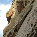 A climber makes her way up one of the many classic climbs in the area.- Castle Rocks State Park