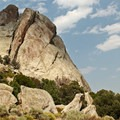A cloud shades the top of a large boulder.- Castle Rocks State Park
