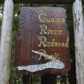 Beautiful redwood sign at the entrance to Gualala River Redwood Park.- Gualala River Redwood Park
