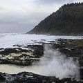 Good Fortune Cove with Cape Perpetua in the distance.- Thor's Well + Cook's Chasm