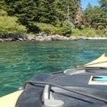 Aquamarine waters in a cove on Carnelian Bay.- Lake Tahoe, Kings Beach to Tahoe City Paddle
