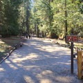 The trail begins at the John Muir Trailhead at Happy Isles. - Vernal Falls Hike via Mist Trail