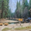 A tranquil Merced River as seen from Northside Drive.- Yosemite Valley Bicycle Loop