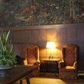 Art that celebrates nature wraps the walls in the Mural Room.- The Ahwahnee Hotel
