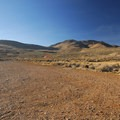 Alvord Hot Spring's gravel camping area.- Alvord Hot Springs