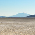 View south over the Alvord Desert toward Pueblo Mountain (8,632').- Alvord Desert