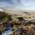 View looking down the western slope of Steens Mountain near Jackman Park.- Jackman Park Campground