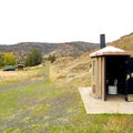 The vault toilet facility at Lone Pine Recreation Site.- Lone Pine Recreation Site